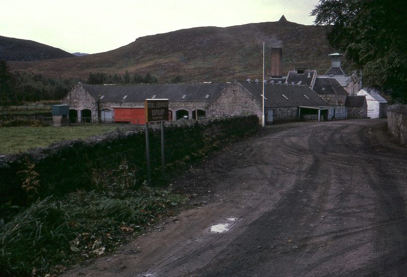 """Royal Lochnagar Distillery, Ballater, Aberdeenshire AB35 5TB, Scotland, about 1km from Balmoral Castle, Sep 1966.<br /> <br /> Google Street View: (Shows the sign and buidlings. Once in Street View one inwards level of zoom shows the buildings well) maps.google.co.nz/maps <a href=""""http://g.co/maps/pmvtp"""">http://g.co/maps/pmvtp</a>"""