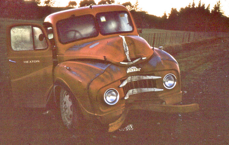 Sadly, the slide of this photo was almost pitch black, but it was too interesting not to post, even if it is my worst (technically) ever upload.<br /> <br /> I don't know who crashed this but I'm guessing it was my Father (then again perhaps it wasn't and he's just getting the blame?) Whoever and whatever happened, they sure did make a good job of it! It certainly was repaired well though, even the number plate is lying on the ground. I learnt to drive this as a young teenager (possibly even younger) and changing down through the gears was a real mission without proper synchromesh gears.<br /> <br /> We bought this farm in 1953 and I think we bought the truck in 1953 also, brand new I think?<br /> <br /> I have no idea who took this, but I'm guessing it may have been my Father, Grandfather, or Grandmother, in order of possibilities.