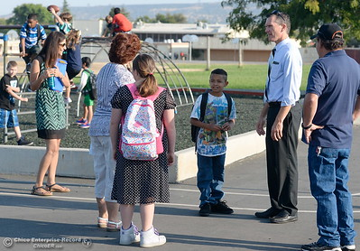 Principal Todd Dowell, second from right, talks with a group as parents and students arrive for the first day of school at Wyandotte Academy in Oroville, Calif. Wed. Aug. 16, 2017.  (Bill Husa -- Enterprise-Record)