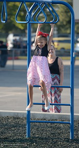 First grader Miley Ammons enjoys the playground with Mom Kimberly Ammons as parents and students arrive for the first day of school at Wyandotte Academy in Oroville, Calif. Wed. Aug. 16, 2017.  (Bill Husa -- Enterprise-Record)