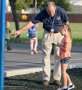 Resource Teacher Steve Connors helps a student on the playground as parents and students arrive for the first day of school at Wyandotte Academy in Oroville, Calif. Wed. Aug. 16, 2017.  (Bill Husa -- Enterprise-Record)
