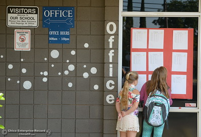 Students look for their name on the list posted in front of the office as they arrive for the first day of school at Wyandotte Academy in Oroville, Calif. Wed. Aug. 16, 2017.  (Bill Husa -- Enterprise-Record)