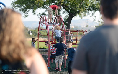 Parents watch as their students arrive for the first day of school and start out on the playground at Wyandotte Academy in Oroville, Calif. Wed. Aug. 16, 2017.  (Bill Husa -- Enterprise-Record)