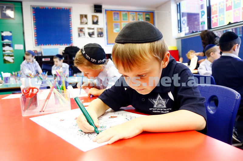 Yeshivah College. xxxx concentration on his drawing. Photo: Peter Haskin
