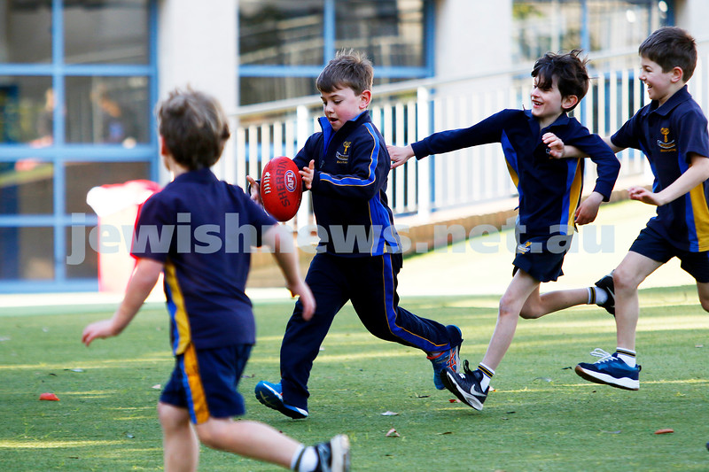 Footy on the play ground at Bialik College. Photo: Peter Haskin