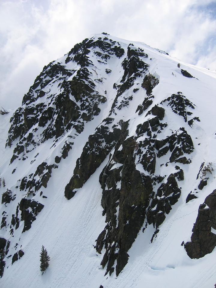 Here is a shot of the chute right next to it.  <br /> <br /> Is this called daddycham?  Isn't that sacreligious to Chamionix?<br /> <br /> Anyway, looks pretty intense, and do-able only in big snow years.