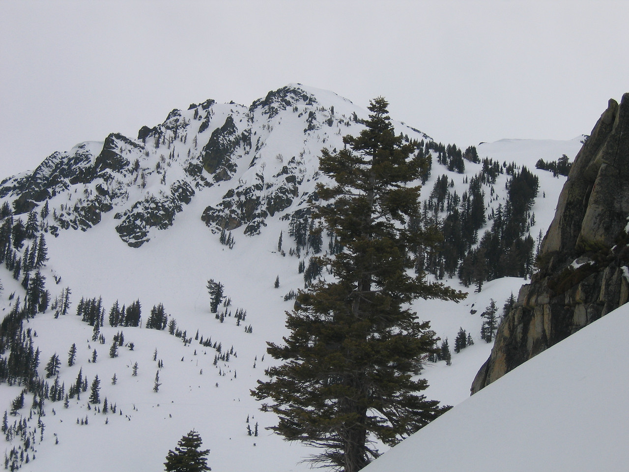 "Turns out Lake Tahoe Community College's backcountry snowboard class was postholing up the skin tracks.<br /> <br /> Here is a pic of the ""front chutes"" of Tallac.  Timmy and I did the ""central couloir"", which is the obvious one left of the hanging snowfield."