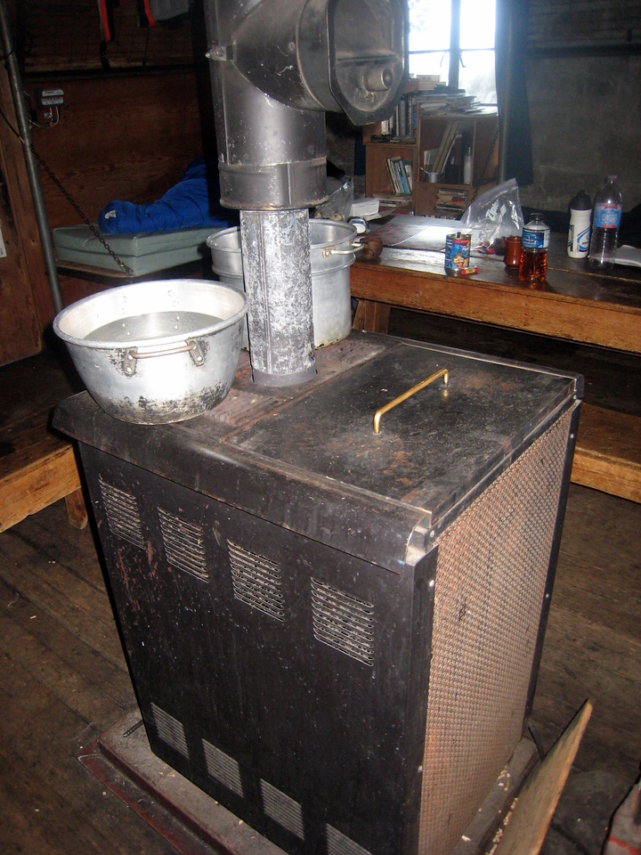 "A Pellet Stove... <br /> <br /> <a href=""http://en.wikipedia.org/wiki/Pellet_stove"">http://en.wikipedia.org/wiki/Pellet_stove</a><br /> <br /> this thing ROCKS. There's a timer that slowly dispenses pellets so the fire lasts all night.  Though it did explode on us a few times. <br /> <br /> <a href=""http://tinyurl.com/5vl4lu"">http://tinyurl.com/5vl4lu</a>"