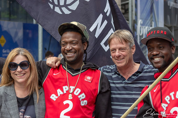 Taking a photo with Raptors flag