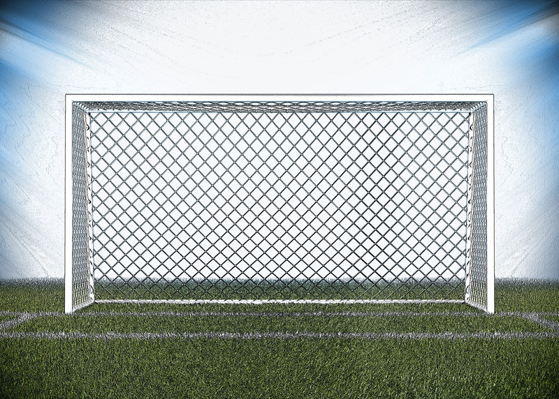 Football (soccer) goals and ball on clean empty green field