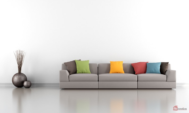 Minimalist living room with white wall and colorful sofa - rendering