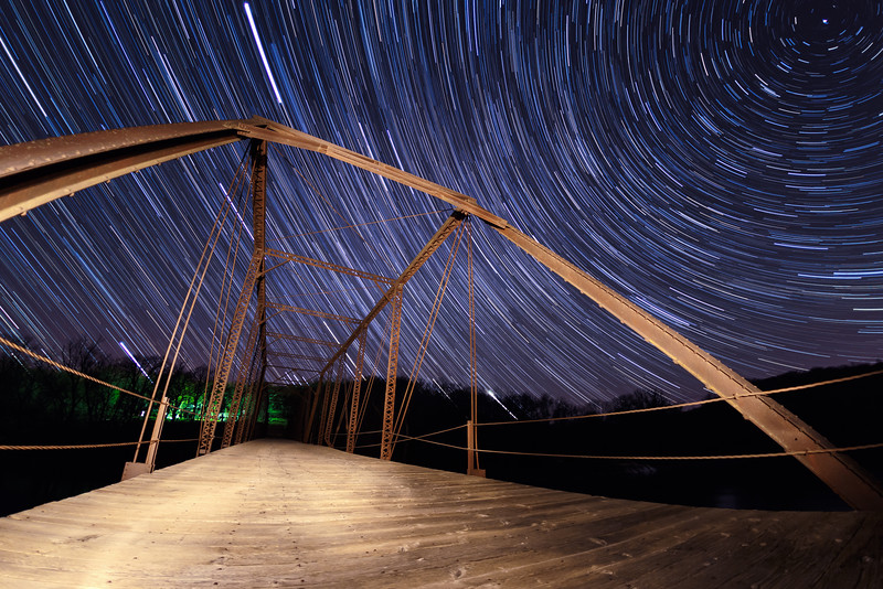 Stars dance around the Wagon Wheel bridge on a spring evening