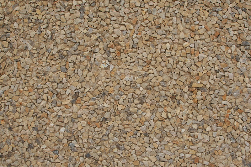 Stone floor of brown, beign and gray rock