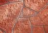 Stone Veneer red rock weathered wall closeup
