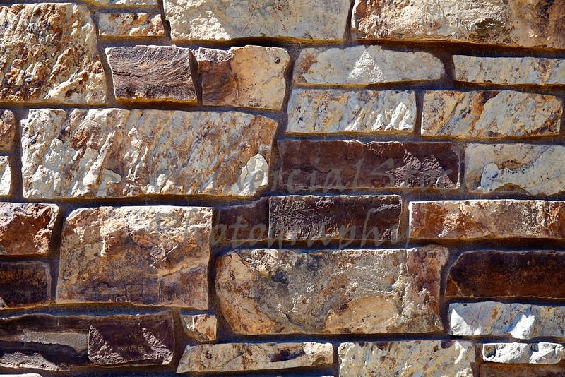 Stone Veneer Natural granite cliff ledge stacked rock wall closeup
