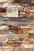 Stone Veneer Natural sandstone granite rock cliff ledge stacked wall closeup