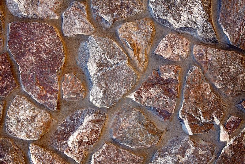 Stone Veneer Natural granite rock rubble wall pattern closeup
