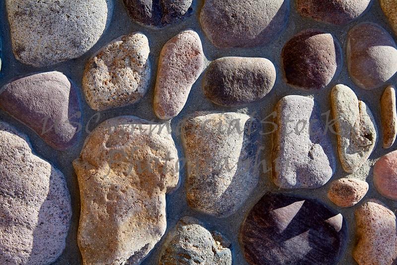 Stone Veneer smooth river rock detail wall closeup