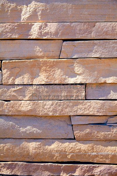 Stone Veneer Natural granite red rock cliff ledge stacked wall closeup