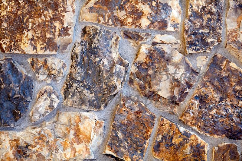 Stone Veneer Natural weathered mineralized granite rock wall closeup