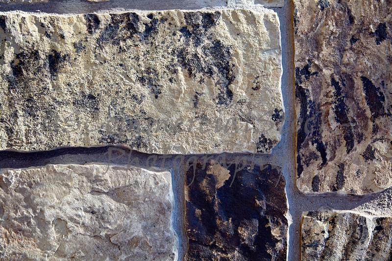 Stone Veneer Natural granite stacked castle rock wall closeup