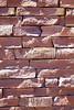 Stone Veneer Natural granite red rock cliff ledge stacked sandstone wall closeup