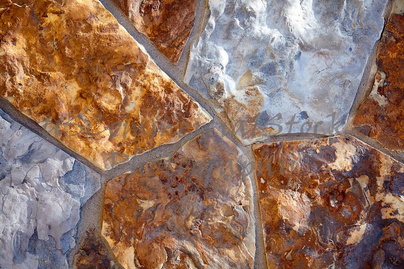Stone Veneer Natural weathered split granite mortar rock wall closeup
