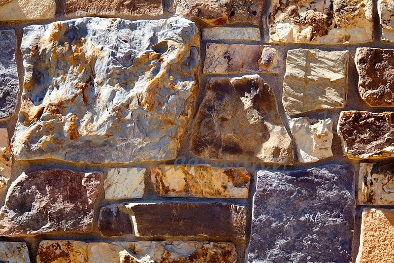 Stone Veneer Natural granite stacked weathered rock wall closeup