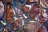 Stone Veneer Natural granite rock rubble mortar wall closeup