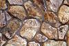 Stone Veneer Natural weathered granite rubble rock wall closeup