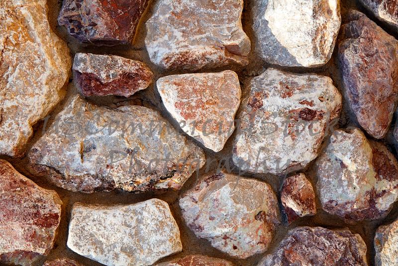 Stone Veneer granite rubble rock wall detail closeup