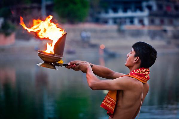 Brahmin performing Aarti pooja ceremony on bank of river Kshipra in Ujjain, Madhya Pradesh, India