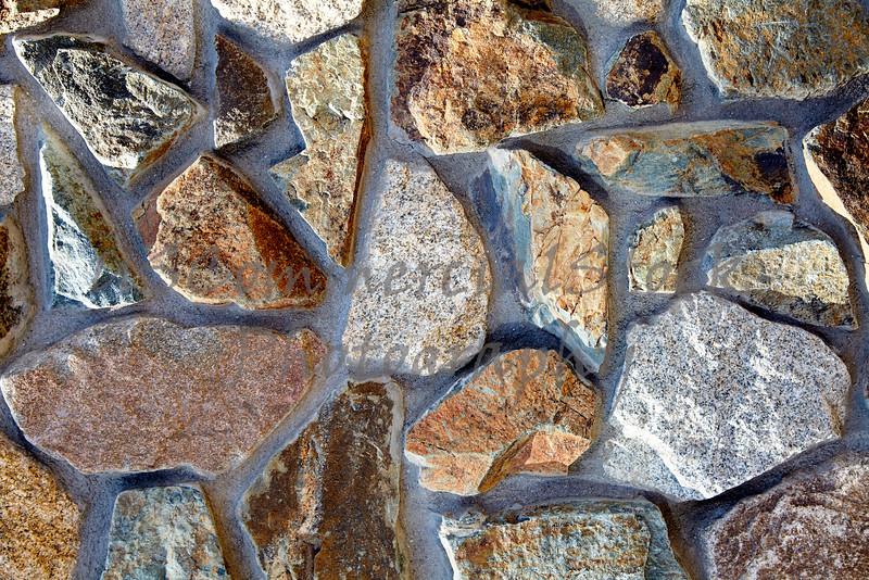 Stone Veneer Natural granite rock rubble mortar wall pattern closeup