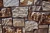 Stone Veneer Natural granite stacked mortar weathered sandstone closeup