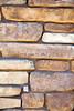 Stone Veneer Natural granite weathered cliff ledge wall closeup