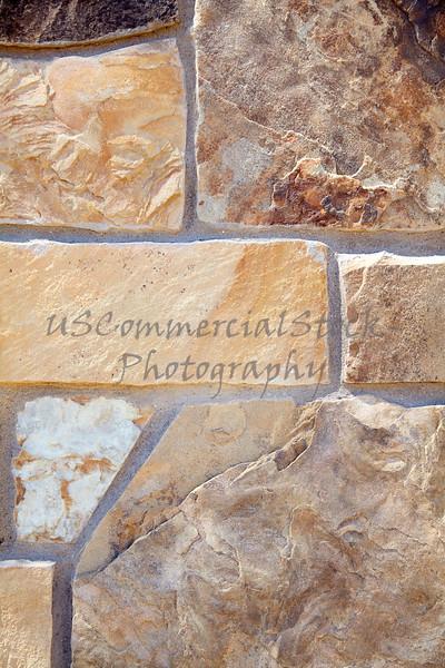 Stone Veneer Natural granite random stack rock wall closeup