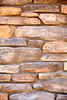 Stone Veneer Natural granite weathered rough cliff ledge wall closeup