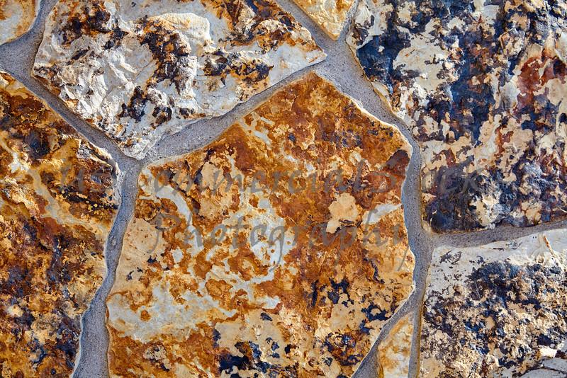 Stone Veneer Natural granite rock flat wathered wall closeup