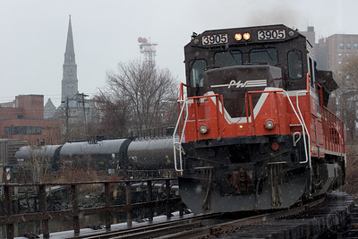 Providence & Worcester train NR-2 enters the NECR's New London, CT yard on a snowy morning