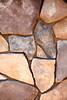 Stone Veneer Natural granite rock mortar wall pattern closeup
