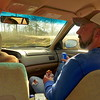 Little Mitten is driving and her cousin Keith sits nearby while I'm in the back as we drive up the mountain approaching the Cherohala Scarway.