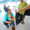 KRISTOPHER RADDER - BRATTLEBORO REFORMER<br /> Eli Honkala, 2, grabs for a backpack at the Brattleboro Auto Mall on Friday, Aug. 25, 2017.