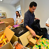 KRISTOPHER RADDER - BRATTLEBORO REFORMER<br /> Ruben Garza, a member of SEVCA, helps pack bags for a backpack at the Brattleboro Reformer building for a giveaway held at the Brattleboro Auto Mall on Friday, Aug. 25, 2017.