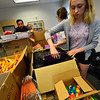 KRISTOPHER RADDER - BRATTLEBORO REFORMER<br /> Tia Achilles, a student at Brattleboro Union High School, helps  pack bags for a backpack at the Brattleboro Reformer building for a giveaway held at the Brattleboro Auto Mall on Friday, Aug. 25, 2017.