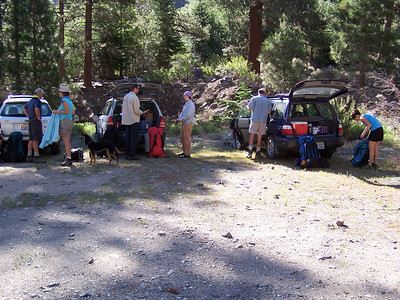 Loading the packs, preparing to head up the trail.