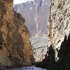 1200 foot clifs of the Santa Ellena Canyon with canoes coming down stream. Left side Mexico and Right side is USA.
