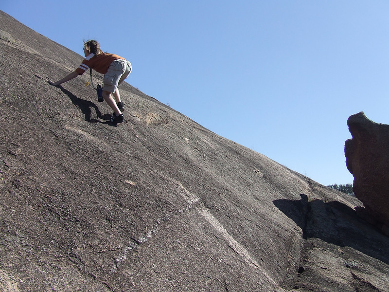 Shay climbing the steep sides of the large Granit Dome.