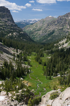 Looking down from the Triangle Lake outlet to one of the greenest valleys I've seen in Colorado. We decided to downclimb the outlet/waterfall so that we could experience the area up close.