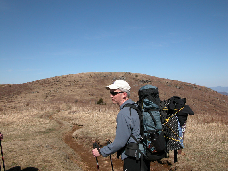 John at the intersection of the spur from the parking lot and the Art Loeb Trail. Black Balsam Knob in the background.
