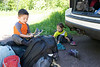 Getting ready for our 3 day backpacking trip at the trail head at Crosby Manitou State Park. The kids put their own socks, shoes, and packs on!